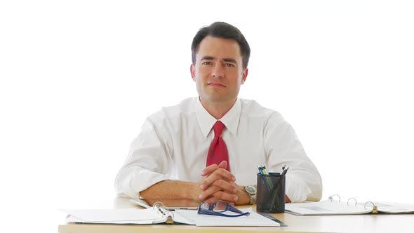 Thumbnail for Businessman leaning forward at desk
