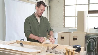 Male Woodworker Working in Workshop on Wood Create Product Made of Wood