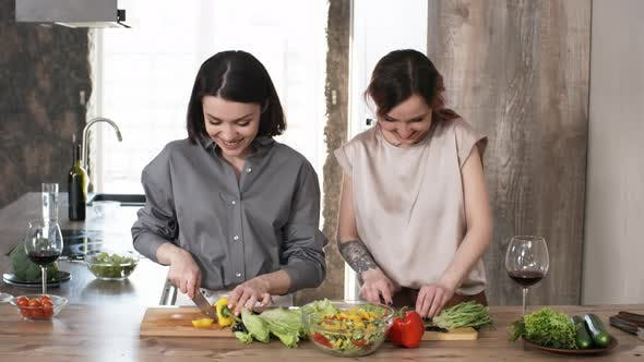Thumbnail for Two Women Cooking Salad Together in Kitchen
