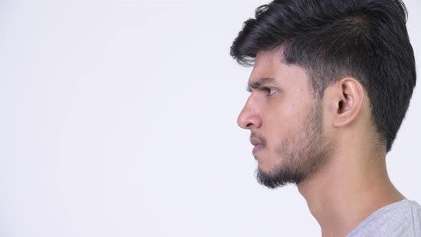 Thumbnail for Profile View of Young Angry Bearded Indian Man Screaming