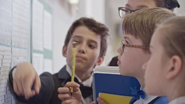 Thumbnail for Schoolchildren Studying New Term Timetable