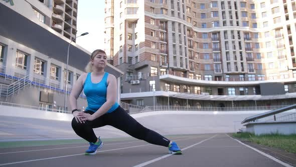Thumbnail for Fat Positive Woman During Warm Up on Sports Ground