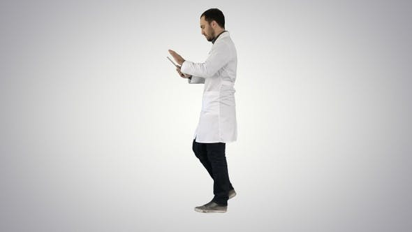 Thumbnail for Doctor Using Tab While Walking on Gradient Background.