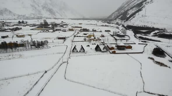 Thumbnail for Drone Motion of Snowy Mountains Village