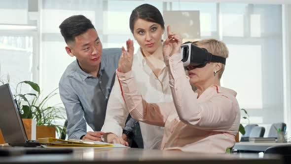 Thumbnail for Mature Businesswoman Using 3d Virtual Reality Goggles at Work