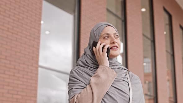 Arabic Woman Making Phone Call Outdoors