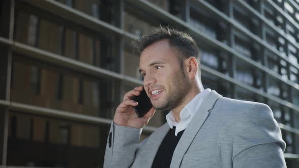 Thumbnail for Businessman Talking on Smartphone at Street. Employee Using Phone Outside