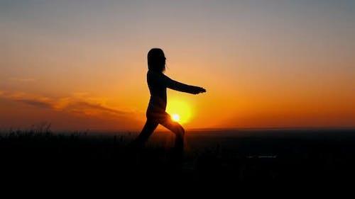 Silhouette Sportswoman Doing Asana in Early Morning