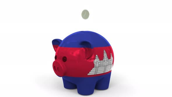 Thumbnail for Coins Fall Into Piggy Bank Painted with Flag of Cambodia