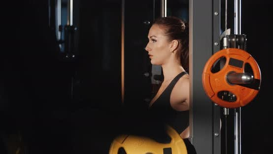 Thumbnail for Athletic Woman Training With Barbell Sport Simulator In Gym Workout Sport