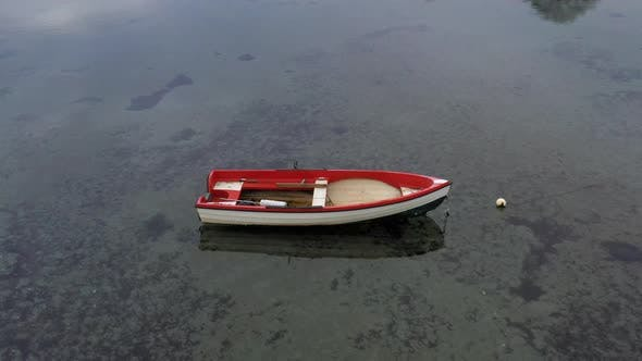 Cover Image for Rowboat with Red and White Color Floating