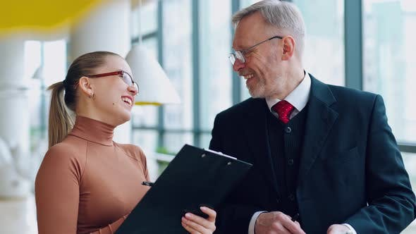 Thumbnail for Smiling old businessman and a female secretary