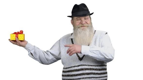 Senior Man Showing Gift Box on White Background