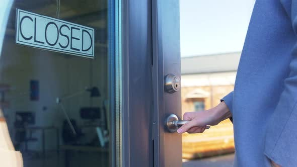 Thumbnail for Woman Trying To Open Closed Office Door