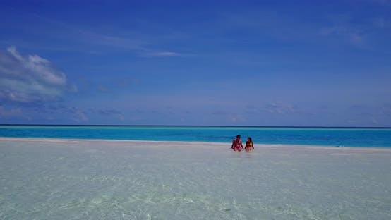 Thumbnail for Fun couple on romantic honeymoon enjoy life on beach on summer white sandy background