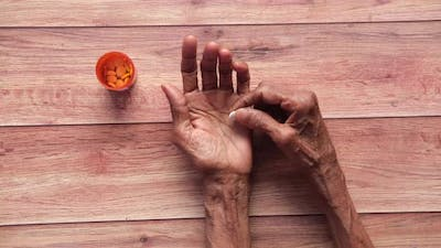 Senior Hand Holding Pills with Copy Space
