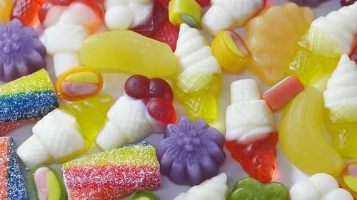 Variety of sweet colorful marmalade jelly candies. Rotation video