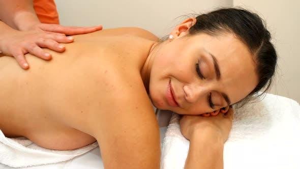 Thumbnail for Masseur Massages Woman's Back
