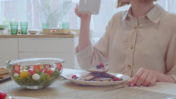 Thumbnail for Young Woman Having Breakfast