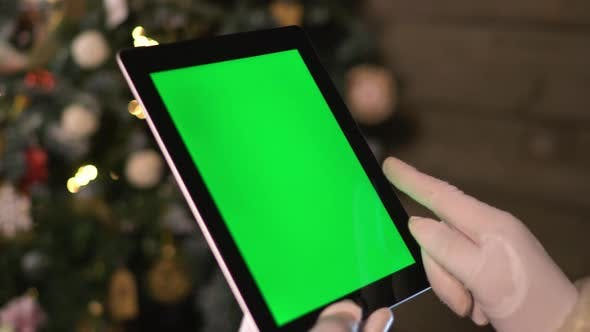 Thumbnail for Santa Choose Gifts on TabletPC. Tablet with Green Screen