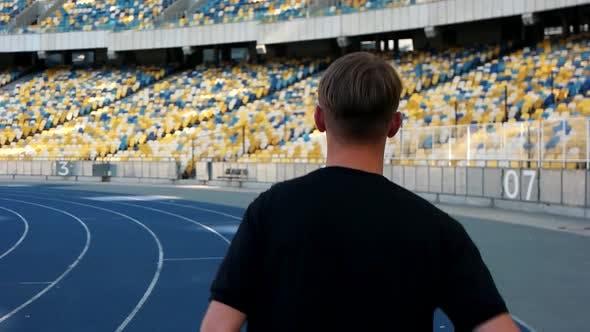 Thumbnail for Guy Runs in the Stadium