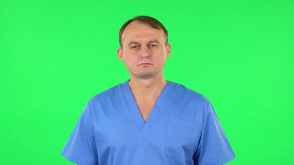 Thumbnail for Medical Man Carefully Looks at the Camera in Frustration, Green Screen
