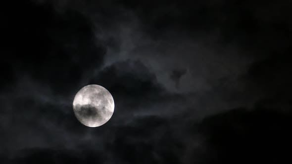 Thumbnail for Full Moon Moving Between Clouds