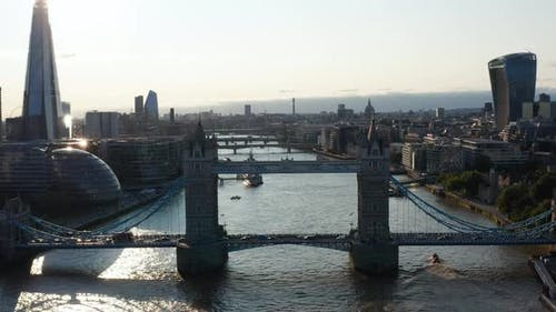 Aerial View of Heavy Traffic on Tower Bridge Across River Thames