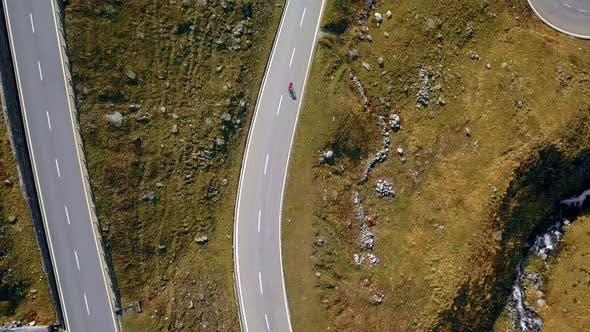 Thumbnail for Road Cyclist Climbs Up Sunset Mountain Switchbacks