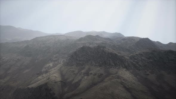 Thumbnail for Sun Rays Against the Backdrop of the Mountains