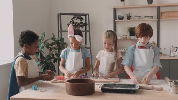 Diverse Children Working in Kitchen