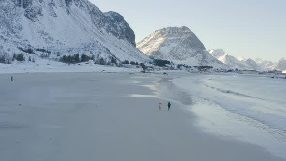 Thumbnail for Children On A Winter Polar Beach