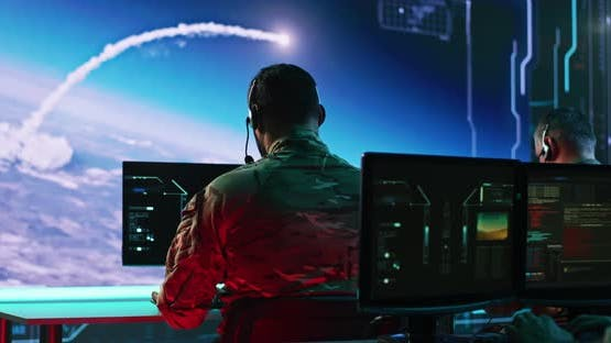 Male Soldiers Launching Nuclear Missiles in Command Center