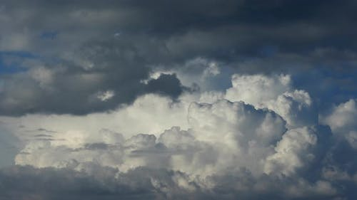Cumulus clouds fast flying sky timelapse.