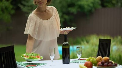Perfect Housewife Sets Table With Healthy Food, Preparation for Celebration