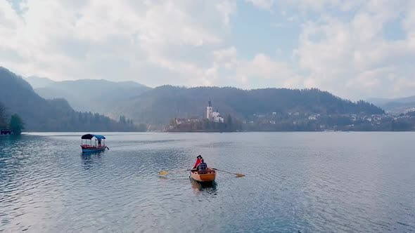 Thumbnail for Young Couple Kayaking Together and Enjoying Magnificent View of the Alph Mountains During Honeymoon