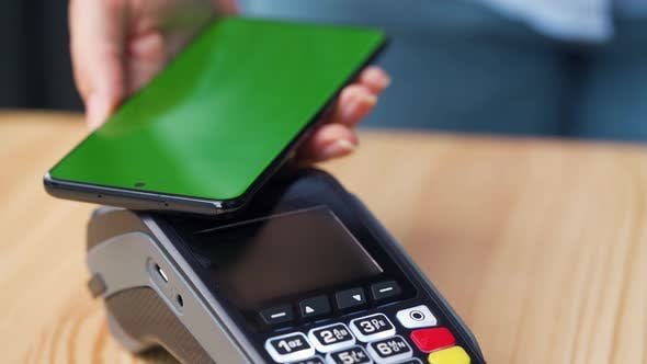 Thumbnail for Contactless Payment with Smartphone with Green Mock-up Screen. Wireless Payment Concept. Close-up