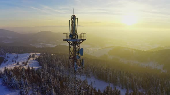 Flying Over Radio Communications Tower Mountain Snow Covered Winter Landscape