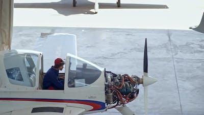 Female Aviator Checking Light Jet