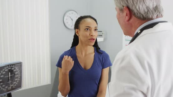 Thumbnail for Black woman explaining concerns to senior doctor