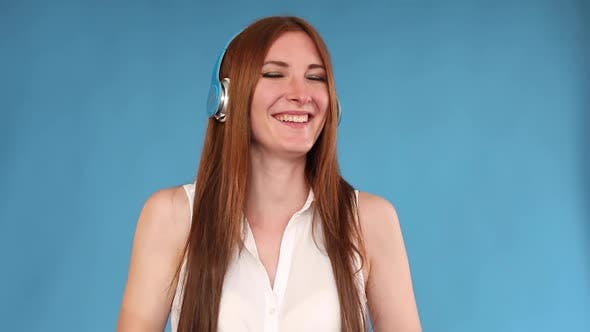 Thumbnail for Girl in Headphones Listening To Music and Laughing