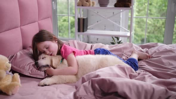 Thumbnail for Cute Little Girl Waking Up Sleepy Puppy in Bedroom