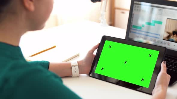 Cover Image for Woman with with Green Screen on Tablet Pc at Home