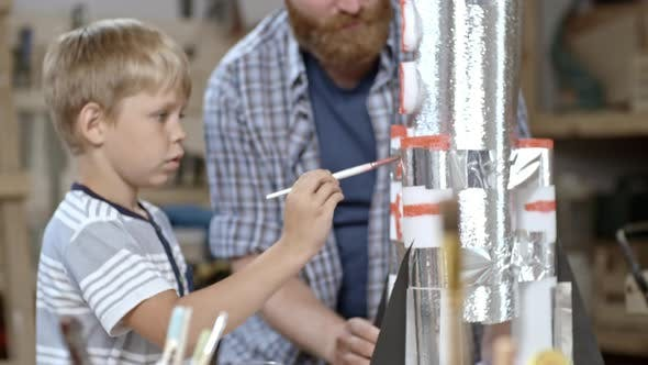 Boy Painting Handmade Rocket