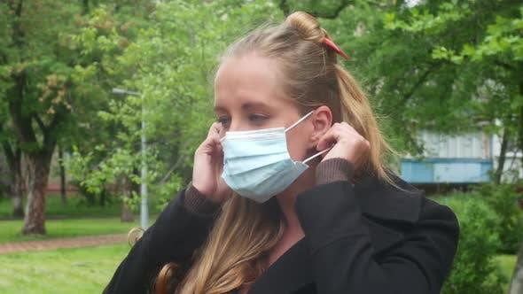 Woman Puts On A Mask