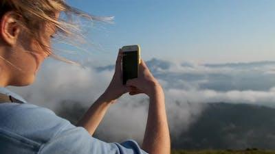 Taking Photo of Breathtaking Landscape As Mementos
