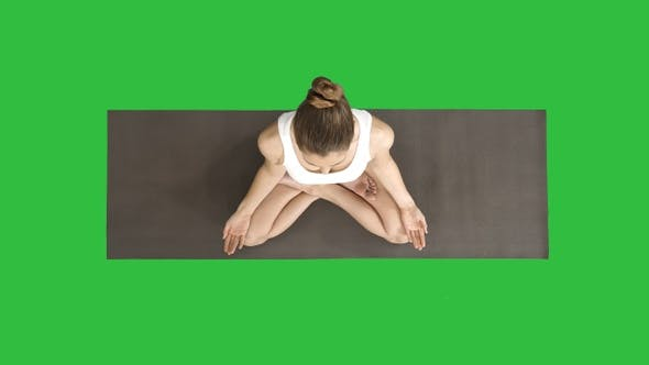 Cover Image for Peaceful blond yoga woman putting hands together and meditating