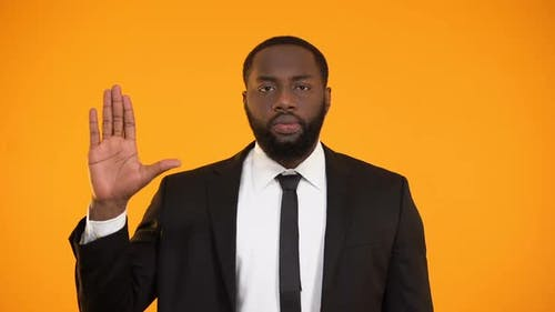 Self-Confident Afro-American Male in Suit Swearing an Oath, Election Campaign