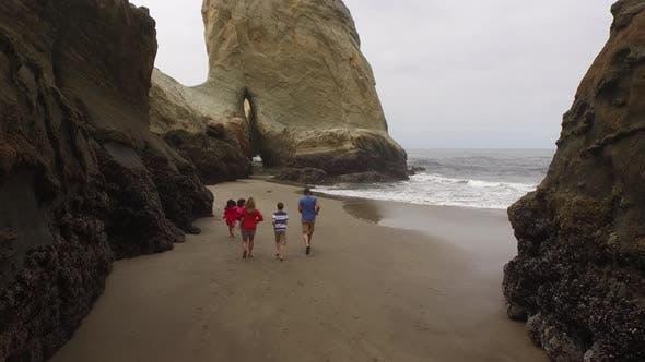 Thumbnail for Family running on beach