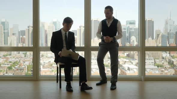 Thumbnail for Two Young Businessman Meeting Talking Together about Financial Business Idea Plan